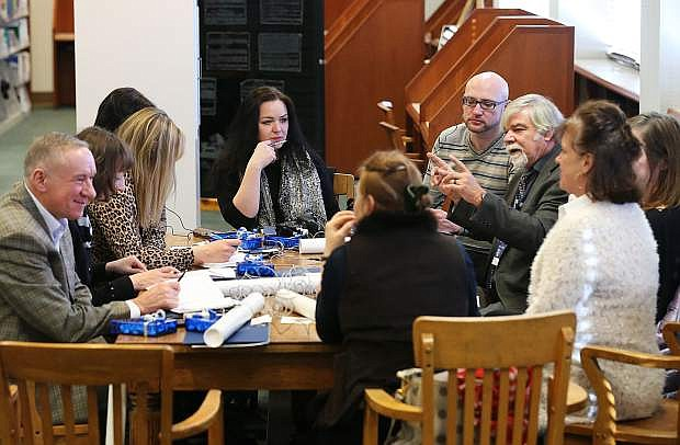Nevada archivist Jeff Kintop, right center, talks to librarians from the Republic of Belarus during their tour the Nevada State Library, Archives and Public Records in Carson City, Nev. on Friday, Jan. 27, 2017. The group is traveling the United States as part of a three-week, multi-state tour to learn about the educational, social and economic impact of public libraries in American society. Photo by Cathleen Allison/Nevada Photo Source