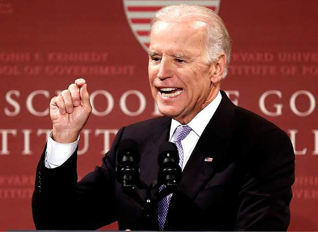 FILE - In this Thursday, Oct. 2, 2014 file photo, Vice President Joe Biden speaks to students, faculty and staff at Harvard University in Cambridge, Mass. Biden is due to headline a Democratic campaign rally in Las Vegas, with a downtown appearance Monday, Oct. 6, 2014, to talk about raising the minimum wage. (AP Photo/Winslow Townson,File)