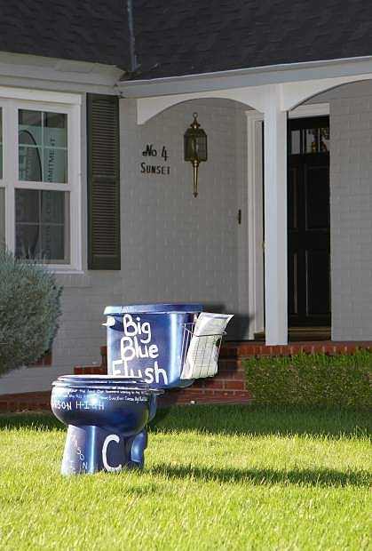 Members of the sophomore class start a fundraiser Wednesday evening by dropping off a bright blue toilet on the lawn of Carson City Mayor Bob Crowell.