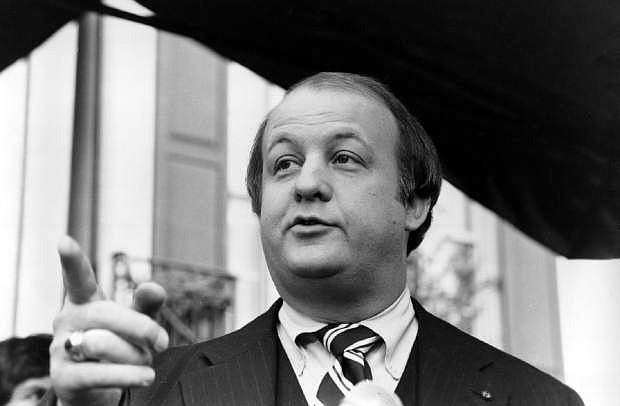 FILE - This Jan. 6, 1981 file photo shows James Brady, selected by president-elect Ronald Reagan to become his press secretary, talking to reporters after the announcement was made in Washington. Brady, the affable, witty press secretary who survived a devastating head wound in the 1981 assassination attempt on President Ronald Reagan and undertook a personal crusade for gun control, died Monday. He was 73. (AP Photo/Walt Zebowski, File)