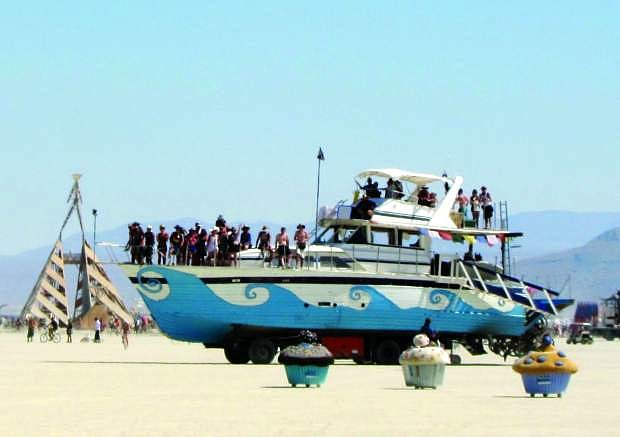 A 65-foot yacht that was pulled from the Tahoe Keys and placed on a cement truck chasis drives around the playa during Burning Man 2011 in Nevada's Black Rock Desert.