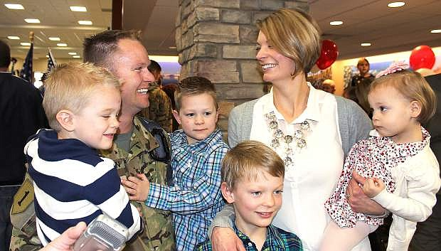 1stLt. Nigel Harrison,  his wife Alyssa and four children reunite Sunday after he returned home from a 10-month deployment to Afghanistan.