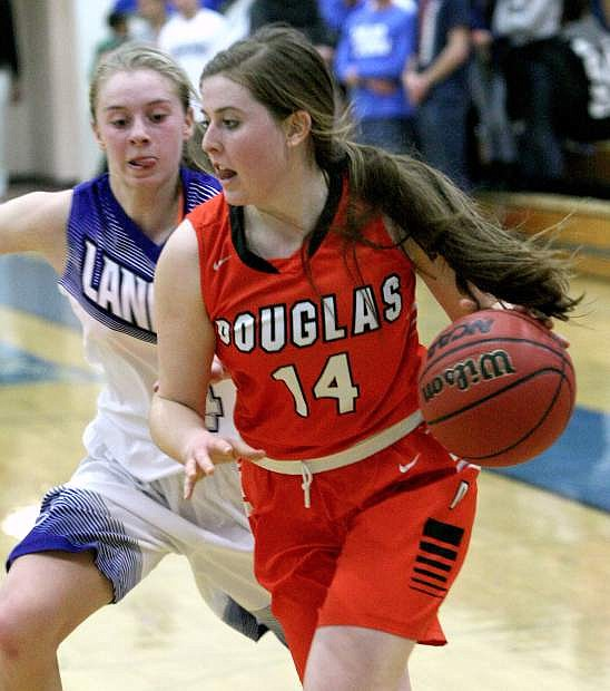 Madison Rodgers of Douglas drives the baseline in a playoff game against McQueen on Tuesday night.