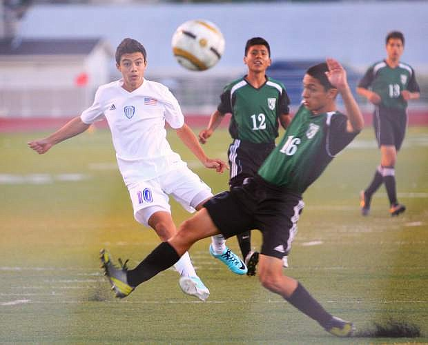 Guillermo Hernandez of CHS takes a shot on goal against Hug Wednesday night at Carson High.