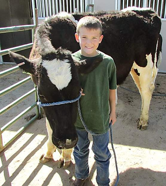 An Arrowhead Livestock 4-H Club member shows his dairy cow at Capital City Farm Days. This year, the event will run from 8:30 a.m. to 2 p.m., April 21 and 22.
