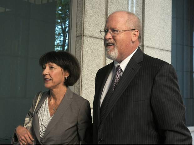 FILE - In this May 14, 2013, file photo, Harvey Whittemore and his wife, Annette, arrive at federal court in Reno for the start of his trial. Whittemore is seeking to overturn his felony conviction and prison sentence for illegal campaign fundraising for U.S. Sen. Harry Reid. Whittemore's lawyers are asking the 9th U.S. Circuit Court of Appeals to toss out his conviction for funneling nearly $150,000 in illegal contributions to  to Sen. Harry Reid's campaign in 2007. (AP Photo/The Gazette-Journal, Marilyn Newton, File)