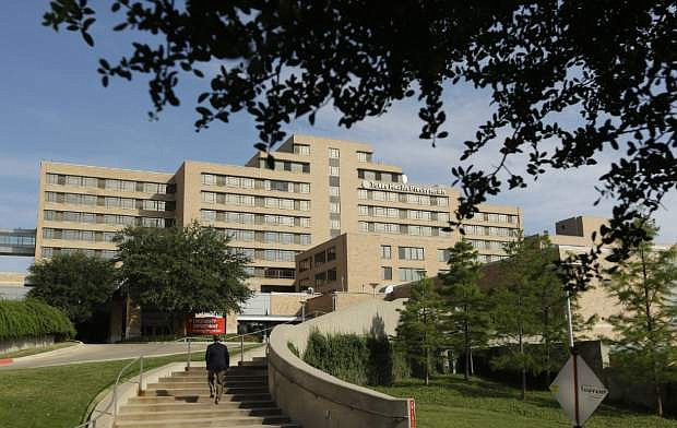 A man walks up the stairway leading to the Texas Health Presbyterian Hospital in Dallas, Tuesday, Sept. 30, 2014.  A patient in the hospital is showing signs of the Ebola virus and is being kept in strict isolation with test results pending, hospital officials said Monday. (AP Photo/LM Otero)
