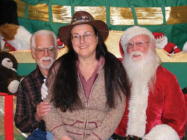 Fred and Maxine Nietz meet with Santa after a successful tree lighting event.