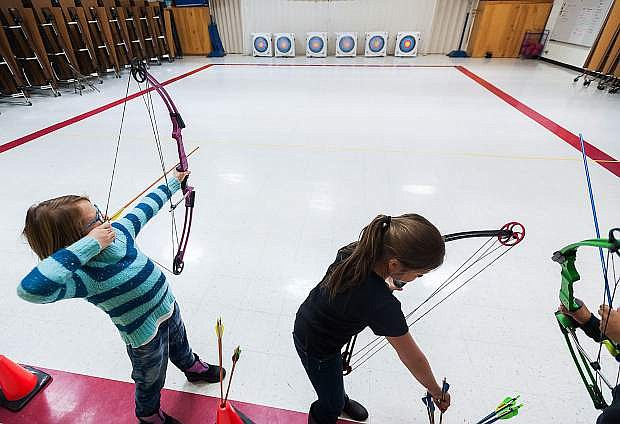 Eleanor Romeo, a 9-year-old competitor for the National Archery in the Schools Program team at Fritsch Elementary School, lines up a shot during practice on Tuesday, Jan. 18, 2017 in Carson City, Nevada. Photo by Kevin Clifford/Nevada Photo Source