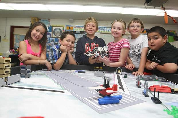 Fritsh Elementary 4th graders, from left, Eviana McGowan, Oscar Salazar, Harper Lopiccolo, Kyra Fields, Nicholas Melsheimer and Oscar Flores display their Lego robot.