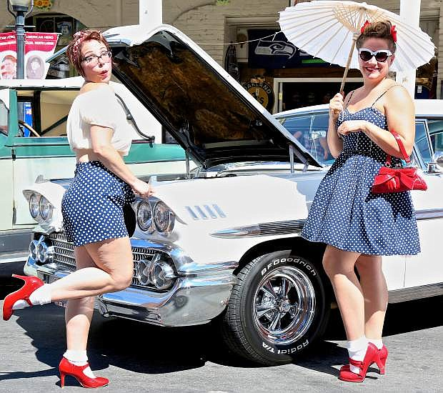 Tamara Thompson of Bend, Or. and her friend Amy Atkins pose in front of a 1958 Chevy Impala Friday in Virginia City.