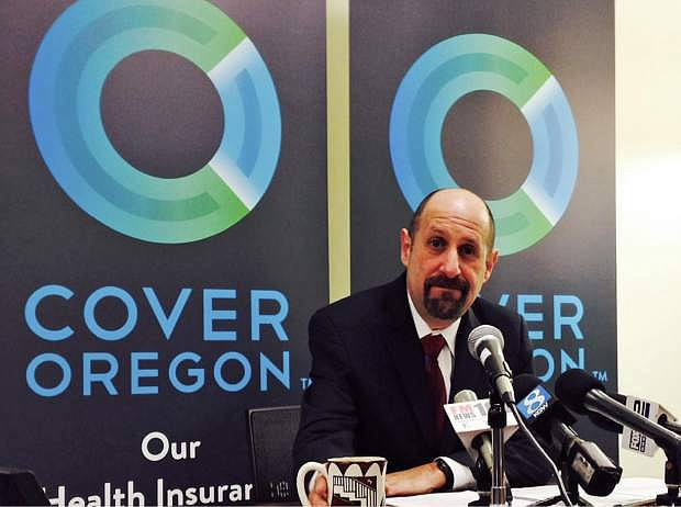 FILE - This Dec. 10, 2013, file photo shows Cover Oregon Executive Director Dr. Bruce Goldberg at a news conference at Cover Oregon headquarters in Durham, Ore. With the open enrollment deadline approaching, some states running their own health insurance exchanges are focused less on getting robust sign-ups than on avoiding total disaster. Nevada, Massachusetts, Vermont, Maryland and Oregon are among the states facing severe technical and administrative problems, which have led to firings of top officials and contract cancellations for key software companies.(AP Photo/Gosia Wozniacka, File)