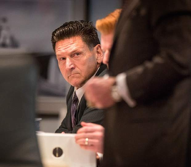 In this photo taken on Monday, Dec. 2, 2103, suspended Clark County Family Court judge Steven Jones attends his Nevada Commission on Judicial Discipline hearing at the Las Vegas Convention Center Boardroom in Las Vegas. The committee is holding a week-long hearing into allegations that Jones mishandled a romantic relationship with a prosecutor who appeared before him. (AP Photo/Las Vegas Review-Journal, Jeff Scheid) LOCAL TV OUT; LOCAL INTERNET OUT; LAS VEGAS SUN OUT