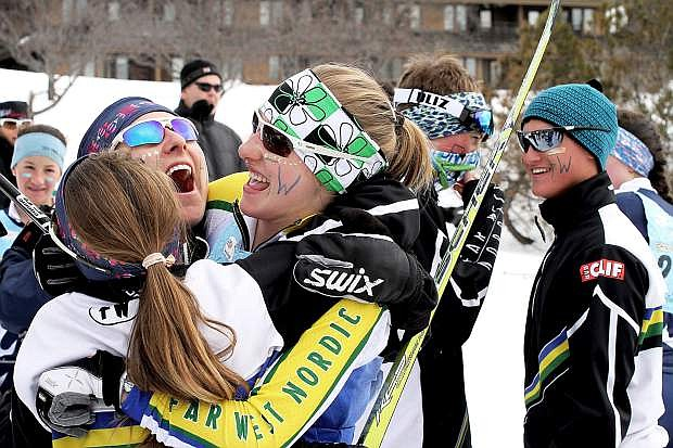 Far West Nordic girls celebrate together during the U.S. Cross Country Ski Junior Nationals in Stowe, Vt.