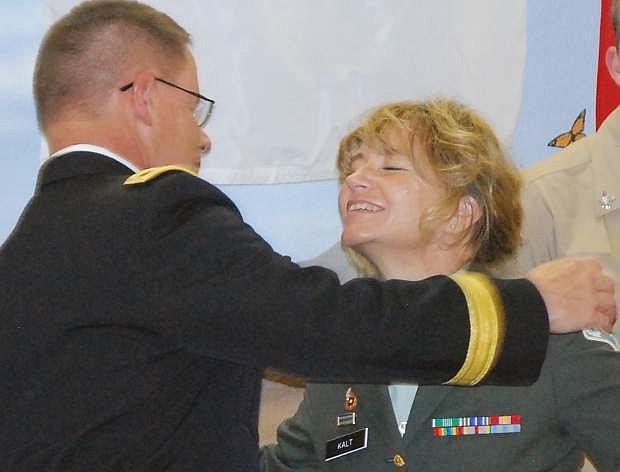 Brig. Gen Mike Hanifan, whose sister is Kieran Kalt, gives her a hug before he spoke at a Veterans Day ceremony in 2013.