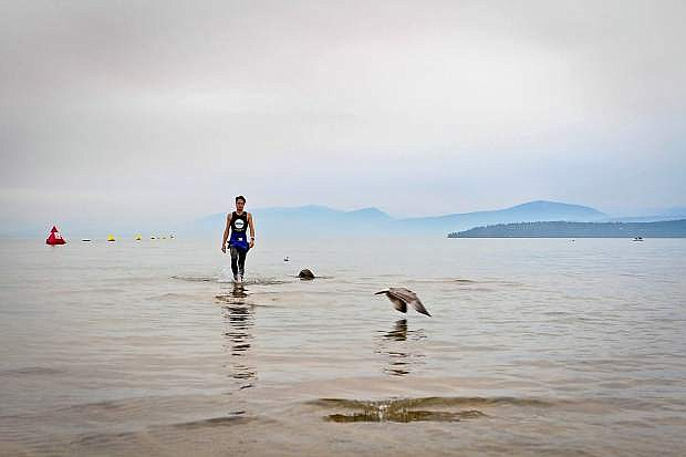 An Ironman competitor took to Lake Tahoe's waters Sunday morning. Despite the race's cancelation, many tri-athletes took a swim in the lake Sunday morning, and many cyclists were on the road as well.