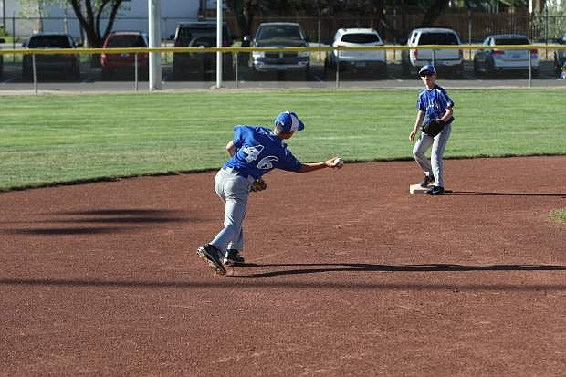 Shortstop Brian Gutherie throws a ball to second baseman Jacob Pettay in a game against Reno Centennial on Saturday.