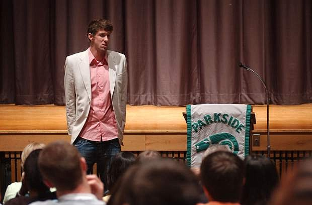 FILE - In this April 18, 2005, file photo, Olympic gold medalist Michael Phelps speaks to a group of seniors at Parkside High School in Salisbury, Md., as part of his sentence after pleading guilty to a DUI charge. Authorities say Phelps has been arrested on a DUI charge in Maryland. Transit police say they stopped the 29-year-old Phelps at the Fort McHenry Tunnel in Baltimore around 1:40 a.m. Tuesday, Sept. 30, 2014. (AP Photo/Matthew S. Gunby, File)