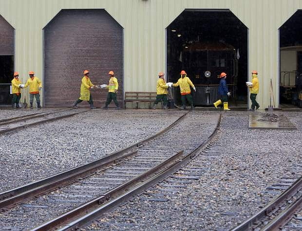 A NDF crew work to sandbag the annex building at the Nevada State Railroad Museum on Tuesday.