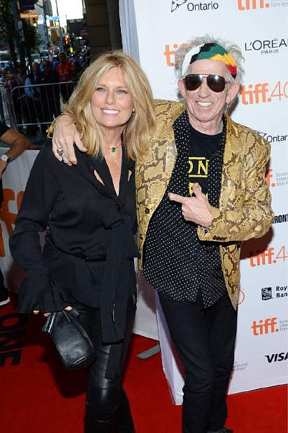 """FILE - In this Sept. 17, 2015 file photo, Keith Richards, right, and his wife Patti Hansen attend a premiere for his film, """"Keith Richards: Under the Influence"""" at the Toronto International Film Festival in Toronto. Richards also released an album, """"Crosseyed Heart,"""" on Sept. 18. (Photo by Evan Agostini/Invision/AP, File)"""