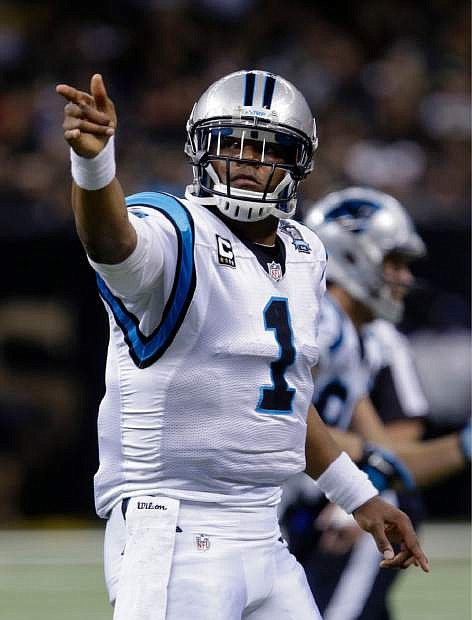Carolina Panthers quarterback Cam Newton (1) gestures after a first down in the first half of an NFL football game against the New Orleans Saints in New Orleans, Sunday, Dec. 7, 2014. (AP Photo/Bill Feig)