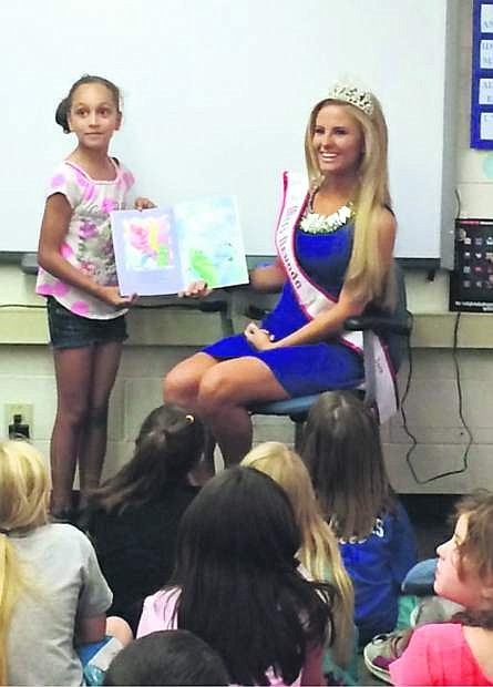 Paris Regan, an alumna of Fritsch Elementary School and a senior at Carson High School, is the reigning Miss Nevada National American Miss Teen 2015. She donated a large box of new books, which were collected at the state pageant, to her alma mater.