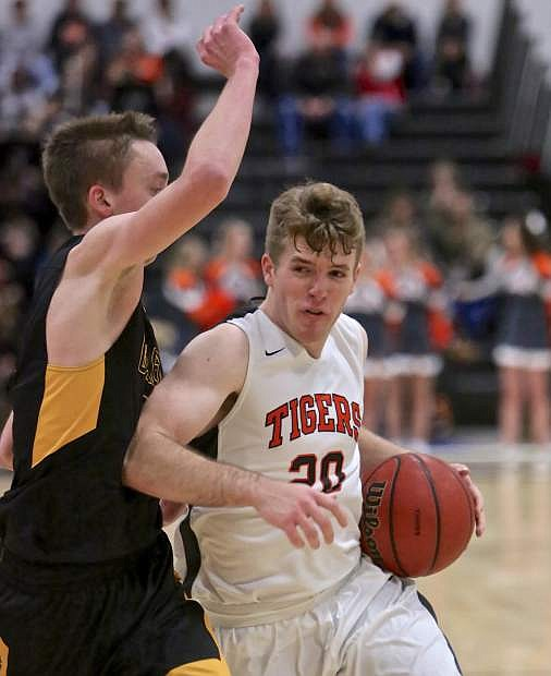 Douglas' Dalton Davis drives to the bucket against Galena Friday night at Keith Green Court. The Tigers would lose to the Grizzlies in overtime.