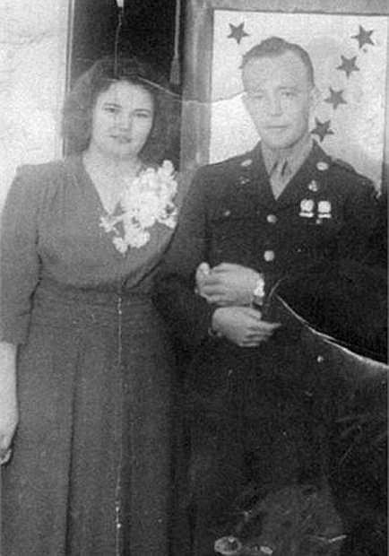 In this undated family photo provided by Kevin Smith is a wedding picture of Pfc. John Farrell Eddington and his wife, Helen. Seven decades after the Missouri soldier died in World War II, Peggy Smith, the daughter he never met is about to get his Purple Heart medal, along with the emotional letter her father wrote just weeks after her birth, at a ceremony Saturday in Dayton.