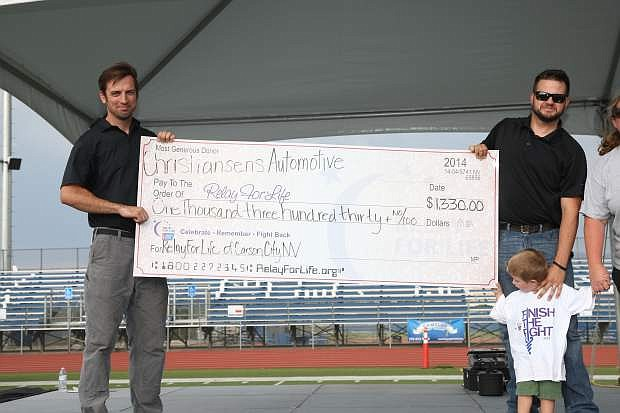 Bryan, Aaron and Cameron Christensen of Christensen's Automotive present a check to Relay For Life Friday at Carson High.
