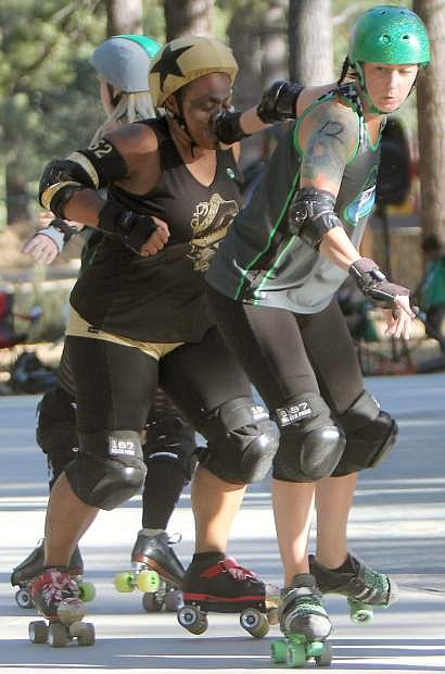Tutu Tuff gives her Carson opponent a face full of wrist guard during a bout Saturday.
