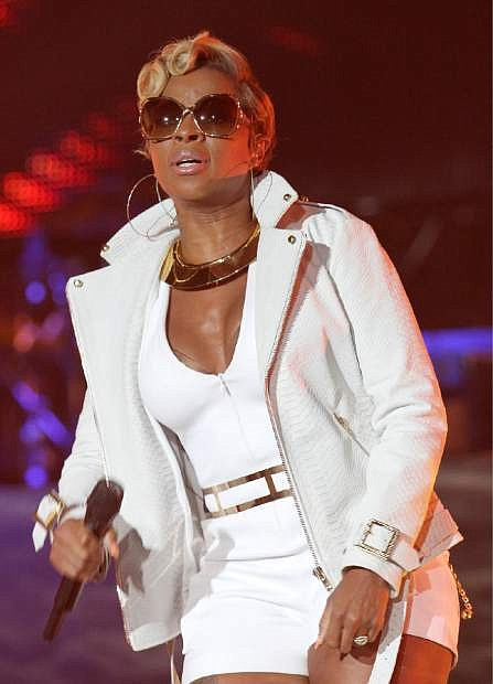 FILE - Mary J Blige is seen performing on stage at the 2014 Essence Music Festival Concert - Day 3 at Superdome in this July 5, 2014 file photo taken in New Orleans, La. Blige performed for a feverish crowd Tuesday night March 17, 2015 at the Samsung Supper Club _ an event not sponsored by South by Southwest and another sign of unofficial concerts rivaling the festival when it comes to pulling big-name acts. (Photo by [Donald Traill/Invision/AP)