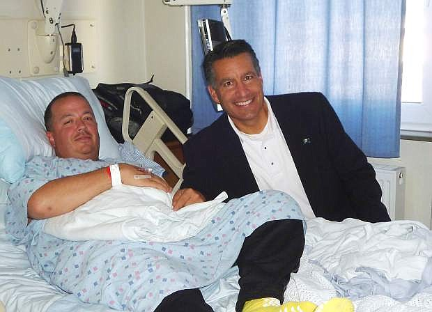 Nevada Gov. Brian Sandoval met with a patient whose wife lives in Dayton at Ramstein Air Base's Landstuhl Regional Medical Center in Germany on Saturday. The Army did not identify the man.