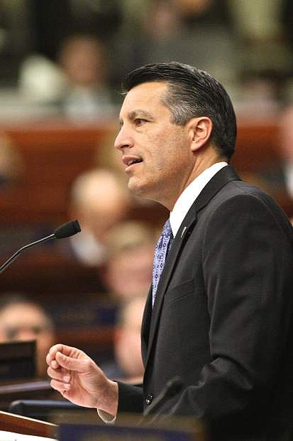 Governor Brian Sandoval speaks to the crowd Thursday night in Carson City in a State of the State address that focused heavily on education in Nevada.