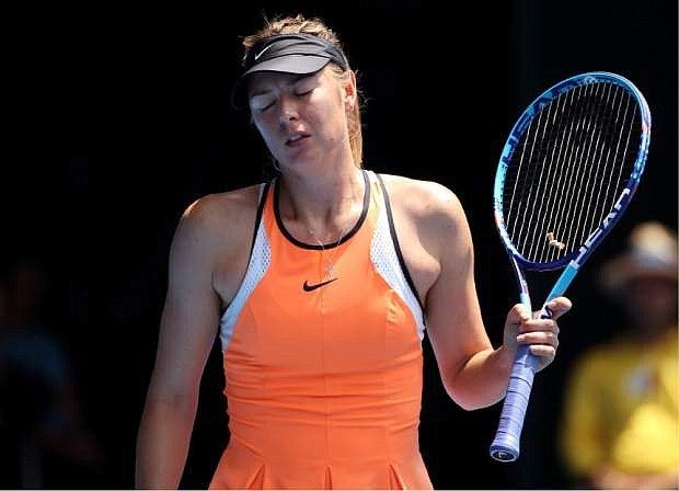 FILE - In this Tuesday, Jan. 26, 2016 file photo, Maria Sharapova of Russia loses a point to Serena Williams of the United States during their quarterfinal match at the Australian Open tennis championships in Melbourne, Australia. Maria Sharapova has appealed her two-year doping ban, Tuesday June 14, 2016, to the highest court in sports, seeking a ruling ahead of the Olympics in Rio de Janeiro (AP Photo/Rick Rycroft, File)