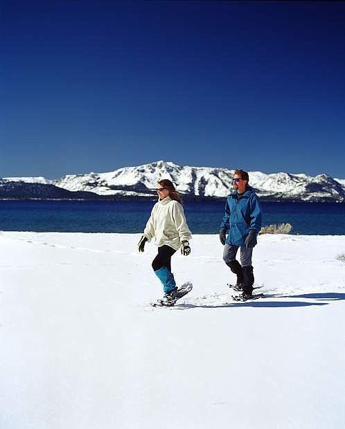 A pair of snowshoers treks along Nevada Beach.