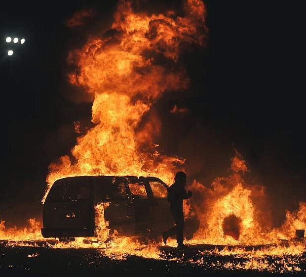 """Josh """"The Crusher"""" Beckel walks out of a  van in flames moments after its explosion as a part of his performance each night of Octane Fest."""