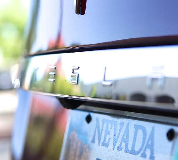 A Tesla Model S is pictured at the Nevada Capitol building in Carson City, not long after the company's deal with the state of Nevada was struck. The deal expected to bring thousands of jobs and millions of dollars in economic growth to the Reno area, some of which should trickle into the Lake Tahoe Basin.