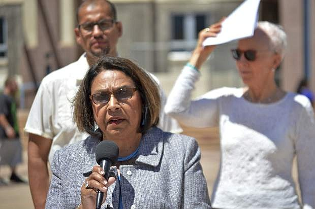 FILE - In this May 5, 2016, file photo, state Rep. Patricia Roybal Caballero, D-Albuquerque, speaks at a press conference by the Democratic Party of New Mexico in downtown Albuquerque, N.M. Caballero has introduced a bill that would prohibit New Mexico police departments or sheriff's offices from cooperating with federal agents in deporting immigrants suspected of living in the country illegally. (AP Photo/Russell Contreras, File)