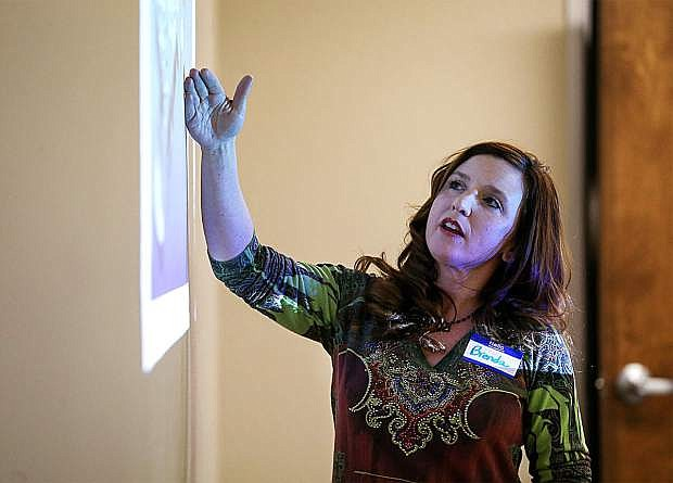 Western Nevada College marketing student Brenda Sweet presents a marketing plan to local business leaders at the Adams Hub on Dec. 8.