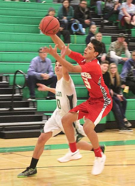 Dalton Kaady (10) and Truckee's Jairo Chavez (3) reach for the ball during Friday's game in the Elmo Dericco gym.