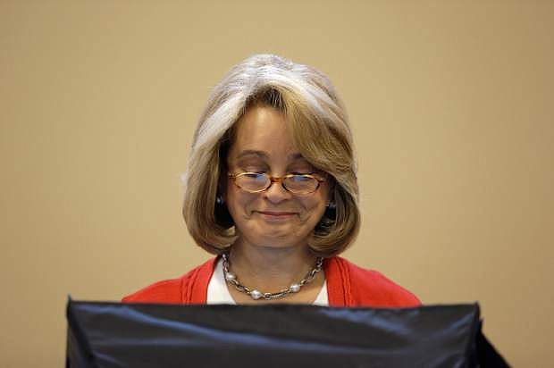 Nevada GOP Lieutenant Governor candidate Sue Lowden casts her primary ballot Tuesday, June 10, 2014 in Las Vegas. Lowden faces Mark Hutchison in the primary. Nevada voters also were deciding primary races for state lawmakers, local officials and judges.  (AP Photo/John Locher)