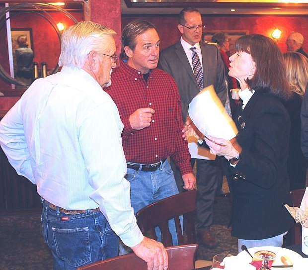 Assemblywoman Robin Titus, right, speaks with Al Trace, left, of the Dairy Farmers of America, and Norm Frey, retired Churchill County Commissioner, after a business breakfast held by the Churchill Economic Development Authority.