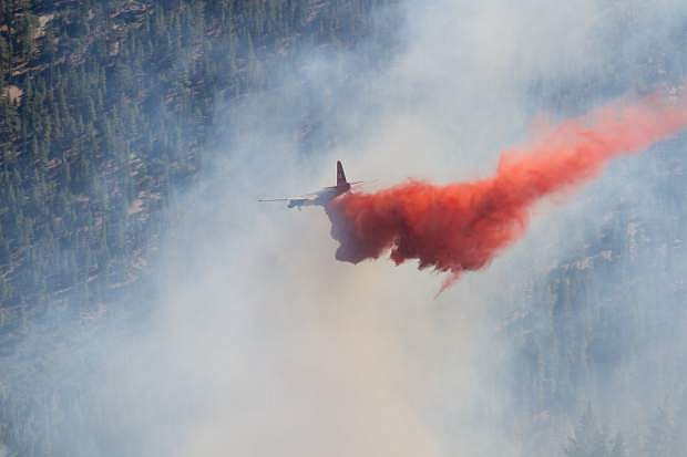 An NDF aircraft lays down retardant on the Kingsbury fire in August 2014. More than $300,000 is available to reduce hazardous fuels on 100 acres of land around Kingsbury Grade.