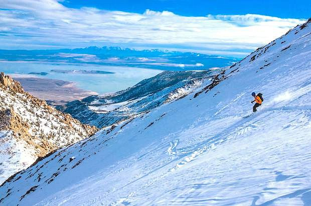 Skiing off the south peak out of Virginia Lakes gives this skier a breath taking view.