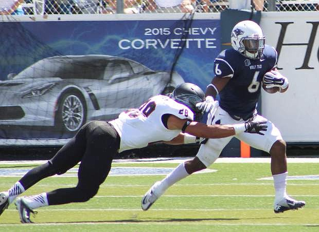 Nevada running back Don Jackson (6) tries to avoid a tackle from Southern Utah's Miles Killebrew (2) in Saturday's season opener for both teams at Mackay Stadium.