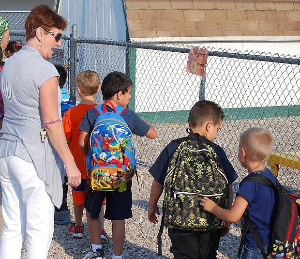 Mary Rudden, an instrutional aide at Northside Early Learning Center, lines up students before Tuesday's first bell rings.