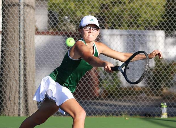 Fallon senior Melanie Nuckolls reaches for the ball in the Lady Wave's regional championship against Truckee in October. She won the regional singles title.