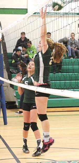 Shaylee Fagg leaps to block a spike from Silverland during Wednesday's CCMS home volleyball match.