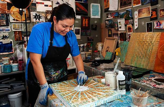 """Melissa Melero-Moose, a Native American artist, paints her new piece, """"Small Basket"""" in her home studio. Melero-Moose is heading the Great Basin Native Artists exhibit at the Carson City Visitors Bureau, which opens Feb. 3."""
