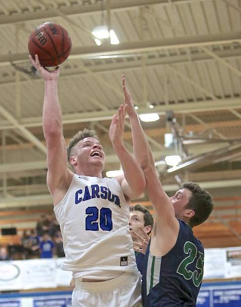 Carson's Tez Allen goes to the hoop in a 59-53 win over Damonte earlier this season.